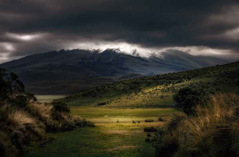 photography of mountains under cloudy sky
