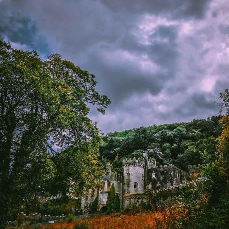 an old castle under dark clouds